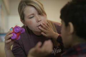 Behavior Advisor Holly Biller works with Micah Rajan, 4, at Texana Center on  Friday, April 7, 2017, in Rosenberg. The Texas Legislature is looking at a bill that would mandate licensure for applied behavior specialists, who often work with autistic people.