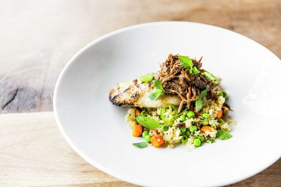 Grilled Gulf fish with braised oxtail and fried rice from the new fish- and vegetable-focused menu at Underbelly. Photo: Julie Soefer / Julie Soefer Photography