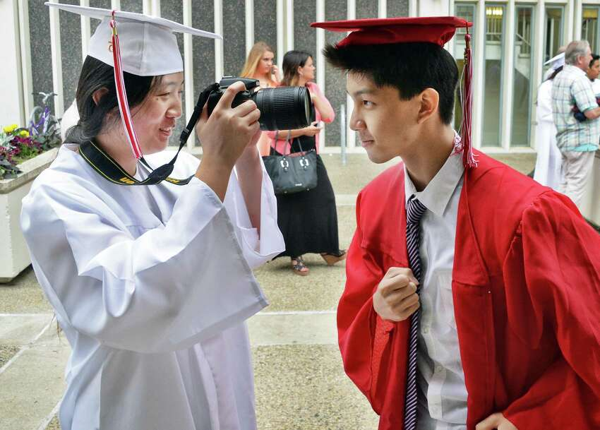 Grads Qingxi Liu, left, and Zesen Lai share a light moment before graduation ceremonies for Guilderland High School at SEFCU Arena Saturday June 27, 2015 in Albany, NY. (John Carl D'Annibale / Times Union)