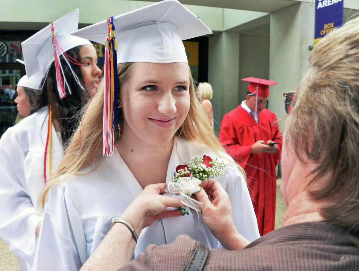 Gwen Sofka has a corsage pinned on her gown by her mother Carla Sofka before graduation ceremonies for Guilderland High School at SEFCU Arena Saturday June 27, 2015 in Albany, NY. (John Carl D'Annibale / Times Union)