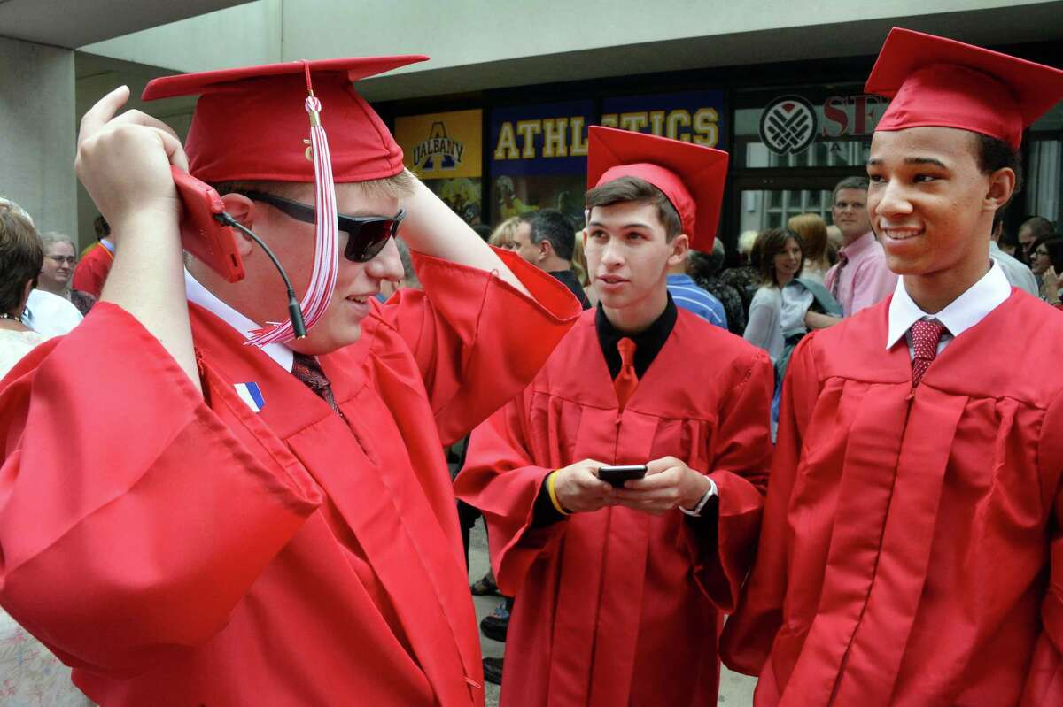 Grads Josh Mattson, left, Zac Kaso and Jah-lik Birch, right ready for graduation ceremonies for Guilderland High School at SEFCU Arena Saturday June 27, 2015 in Albany, NY. (John Carl D'Annibale / Times Union)