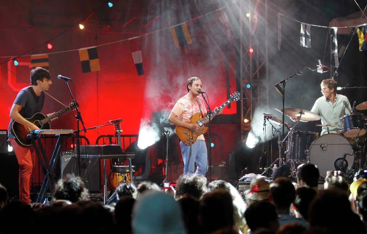 Members of the band Grizzly Bear, from left, Ed Droste, Daniel Rossen and Christopher Bear perform during StePhest Colbchella '012 Rocktaugustfest at the Intrepid Sea, Air & Space Museum, Friday, Aug. 10, 2012, in New York.