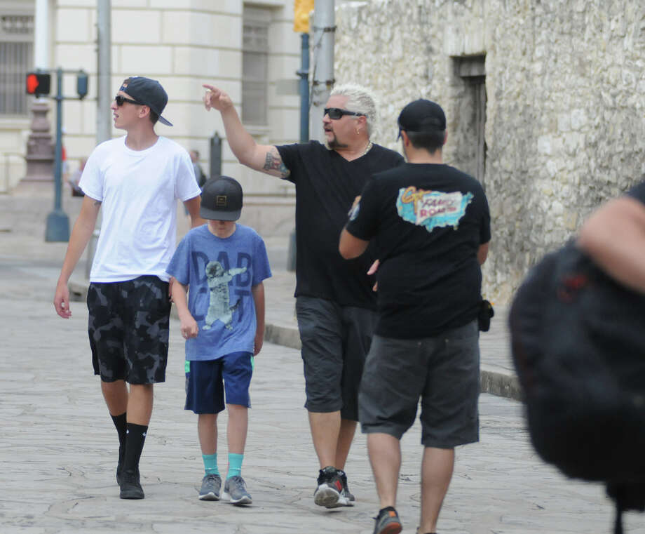 Food Network star Guy Fieri strolled through downtown San Antonio with a film crew Monday afternoon including a stop at the Alamo. Fiery has visited several spots in the Southwest United States in recent weeks and has posted about it on social media using the hashtag #GuysFamilyRoadTrip. Photo: Paul Stephen, San Antonio Express-News