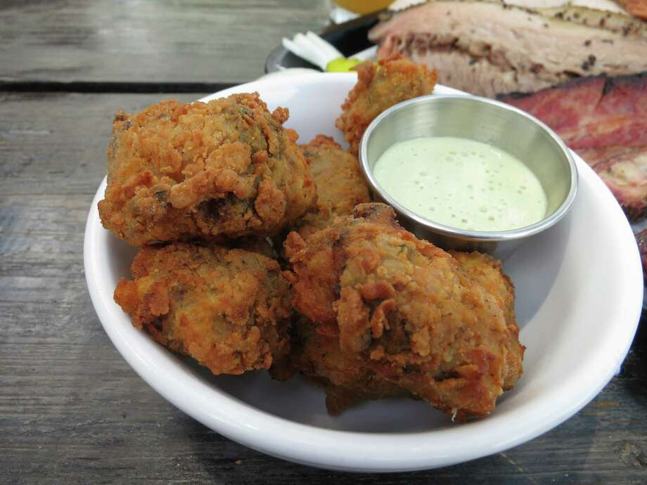 Southern Goods' Popcorn Brisket is smoked-then-fried chunks of brisket with poblano buttermilk ranch sauce. Photo: J.C. Reid