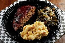 The bacon-wrapped smoked meatloaf, served with mac and cheese and collard greens, is a cult favorite at Pappa Charlies Barbeque.