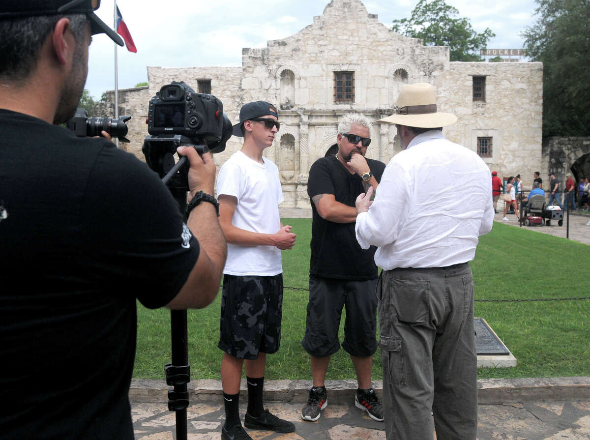 Food Network star Guy Fieri strolled through downtown San Antonio with a film crew Monday afternoon including a stop at the Alamo. Fiery has visited several spots in the Southwest United States in recent weeks and has posted about it on social media using the hashtag #GuysFamilyRoadTrip.