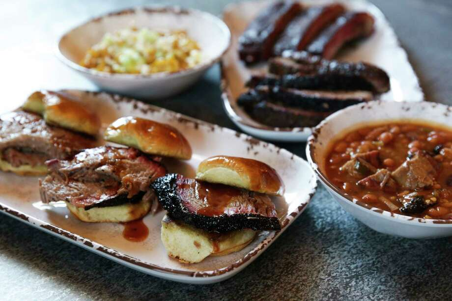 Smoke'n Honey House serves brisket sliders, beans, corn, ribs and sliced brisket, among other fare. Photo: Michael Ciaglo, Staff / Michael Ciaglo
