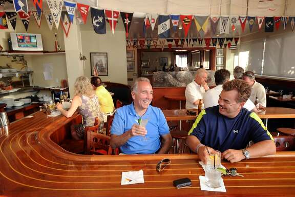 Rich Amaro, left, and Greg Di Loreto share a laugh over drinks at the Walnut Creek Yacht Club on Monday, July 6, 2009, in Walnut Creek, Calif.