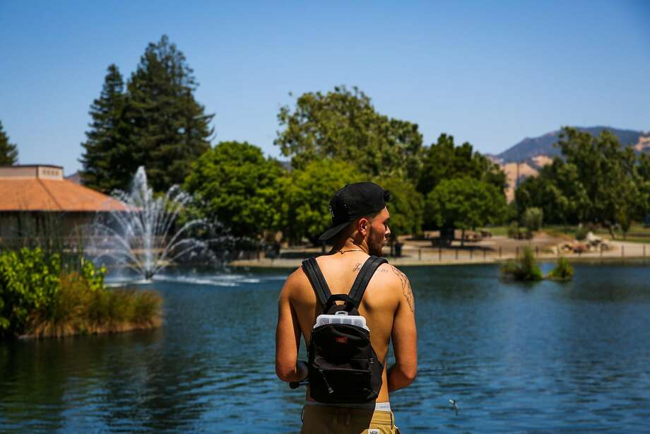 Derrick Dizon, 21, fishes at Heather Farms Park Lake in over 100 degree weather in Walnut Creek, California, on Monday, June 19, 2017. Forecasters warned the cooling trend will be brief and that temperatures are expected to climb back up starting Wednesday. Photo: Gabrielle Lurie, The Chronicle