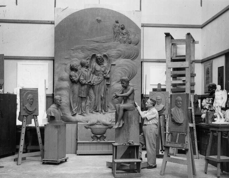 Sculptor Pompeo Coppini, whose best known work in San Antonio is the Alamo cenotaph, is seen here among many of his works. Photo: Express-News File Photo