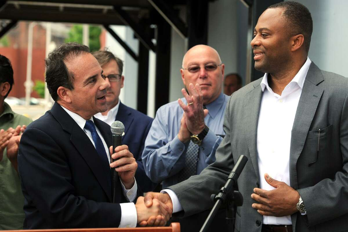 Mayor Joe Ganim shakes hands with Developer Craig Livingston of Exact Capital Group in front of the Majestic Theater in Bridgeport, Conn. June 19, 2017. The City of Bridgeport announced that Exact Capital Group has been selected as the developer for a massive redevelopment project centered around the old Poli Theaters on Main Street.