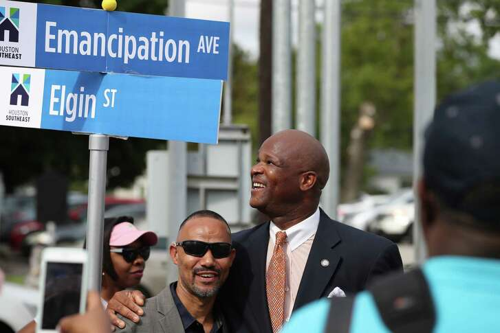 Gene Coleman Donahue (left) has his photo taken with Councilman Dwight Boykins after the re-naming of the former Dowling Ave. to the new Emancipation Ave. Monday, June 19, 2017, in Houston. ( Steve Gonzales  / Houston Chronicle )