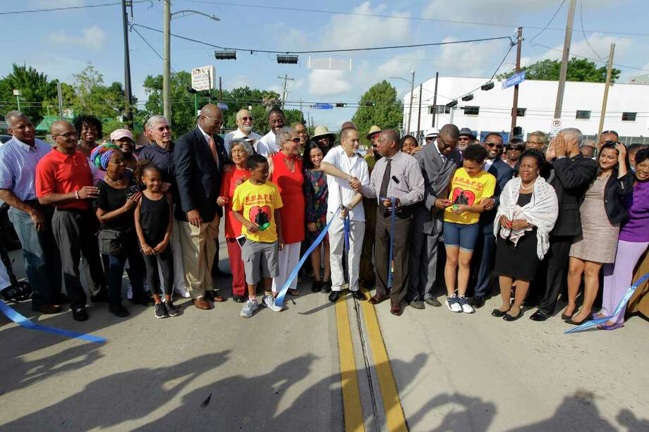 State Rep. Garnet Coleman and Houston Mayor Sylvester Turner shake hands after the ribbon-cutting for Emancipation Avenue, formerly Dowling Street, on Monday, June 19, 2017, in Houston. ( Steve Gonzales  / Houston Chronicle ) Photo: Steve Gonzales, Staff / © 2017 Houston Chronicle
