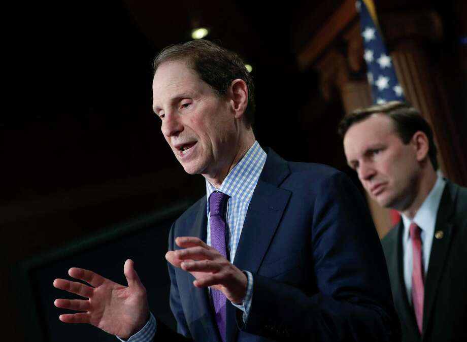 Sen. Ron Wyden, D-Ore., joined by Sen. Chris Murphy, D-Conn., right, hold a news conference to criticize the tax breaks in the GOP-authored American Health Care Act on June 6. (AP Photo/J. Scott Applewhite) Photo: J. Scott Applewhite, STF / AP