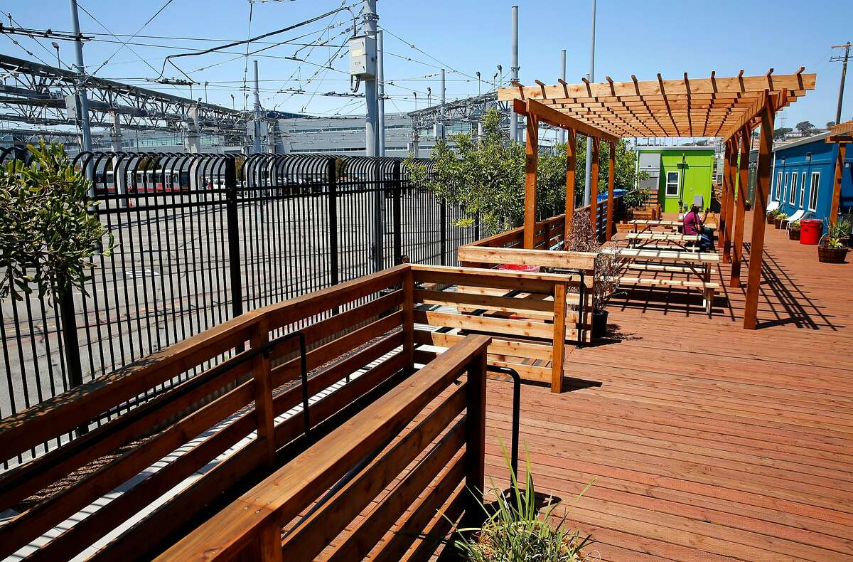 The San Francisco Municipal Railway transit system maintenance shop, (left) borders the newly completed Dogpatch Navigation Center in San Francisco, Ca., as seen on Monday June 19, 2017.