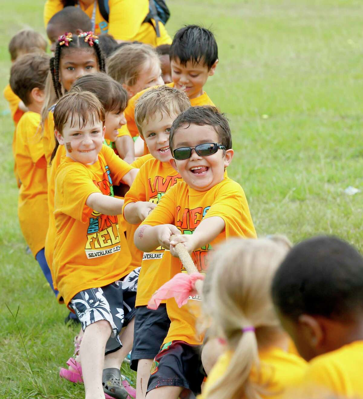 A kindergarten class enjoys a game of tug -of -war as part of the Field Day events at Silverlake Elementary School in Pearland, Texas. (Chronicle File Photo)