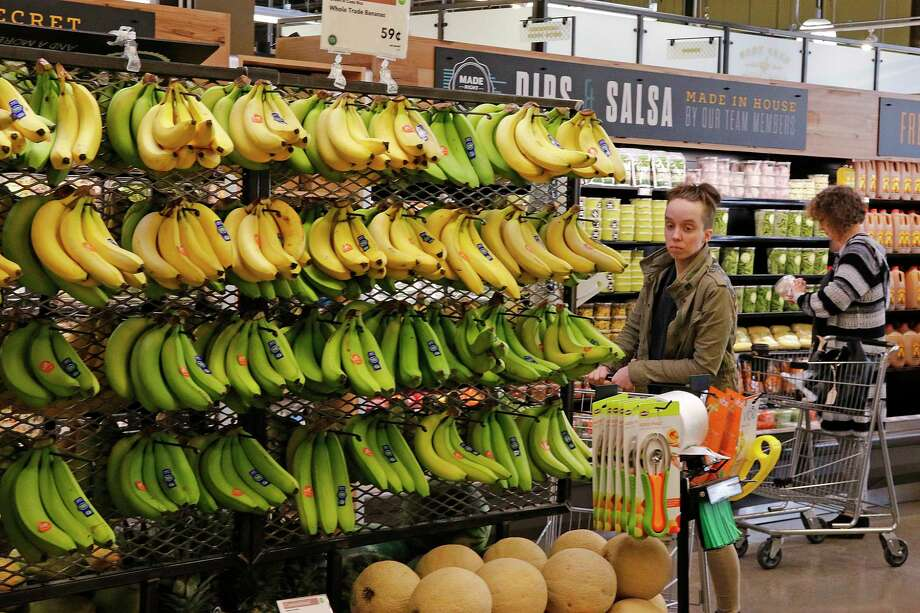 In this May 3, 2017, photo, customers shop at a Whole Foods Market in Upper Saint Clair, Pa. Amazon's planned $13.7 billion acquisition of Whole Foods signals a massive bet that people will opt more for the convenience of online orders and delivery or in-store pickup, putting even more pressure on the already highly competitive industry. (AP Photo/Gene J. Puskar) ORG XMIT: NYBZ112 Photo: Gene J. Puskar / Copyright 2017 The Associated Press. All rights reserved.