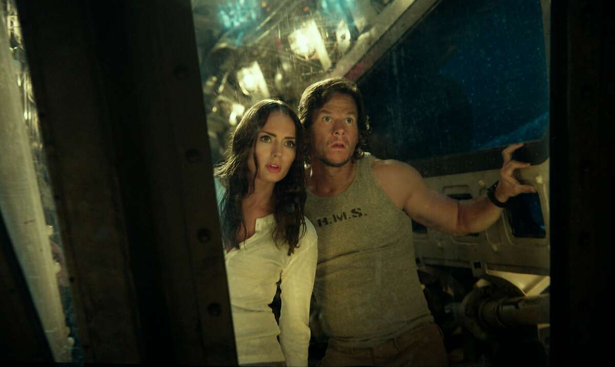 Laura Haddock as Viviane, left, and Mark Wahlberg as Cade Yeager in a scene from,