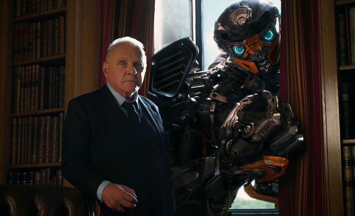 Anthony Hopkins as Sir Edmound Burton, and Hot Rod in a scene from,