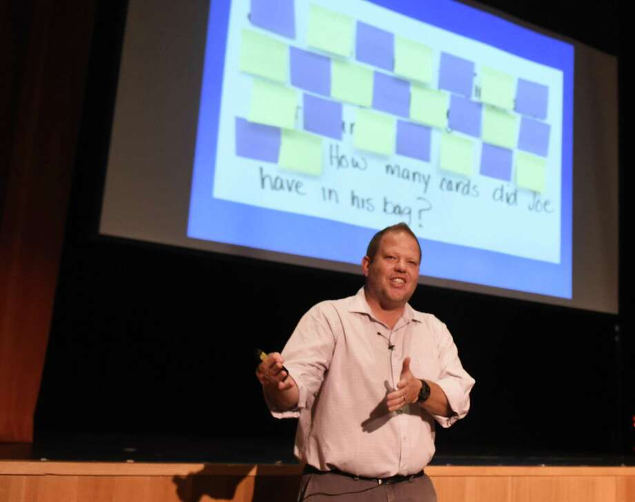 Mathematics educator Graham Fletcher speaks at a math workshop at Greenwich Country Day School in Greenwich, Conn. Monday, June 19, 2017. Flecther is conducting a two-day intensive workshop for educators at GCDS as well as many other math teachers across the region and country. Monday night, he discussed the role of problem solving as a tactical tool for building students' understanding of concepts. Photo: Tyler Sizemore / Hearst Connecticut Media / Greenwich Time