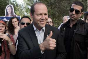 Jerusalem Mayor and candidate for the municipal elections, Nir Barkat gestures as he walks in a street campaigning on October 22, 2013 in Jerusalem during Israels municipal elections. Israelis are voting in municipal elections in a poll likely to be shunned by much of the public who see local authorities as tainted by corruption.   AFP PHOTO/MENAHEM KAHANAMENAHEM KAHANA/AFP/Getty Images