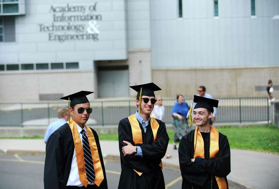 New graduates, from left, 18-year-old Matt Nowogrodzki of Greenwich, 19-year-old Jake Chelombitko of Norwalk and 17-year-old Max Allen of Stamford pose for a photo before the Academy of Information Technology and Engineering (AITE) graduation inside the Rippowam Middle School auditorium in Stamford, Conn. on Monday, June 19, 2017. Photo: Michael Cummo, Hearst Connecticut Media / Stamford Advocate