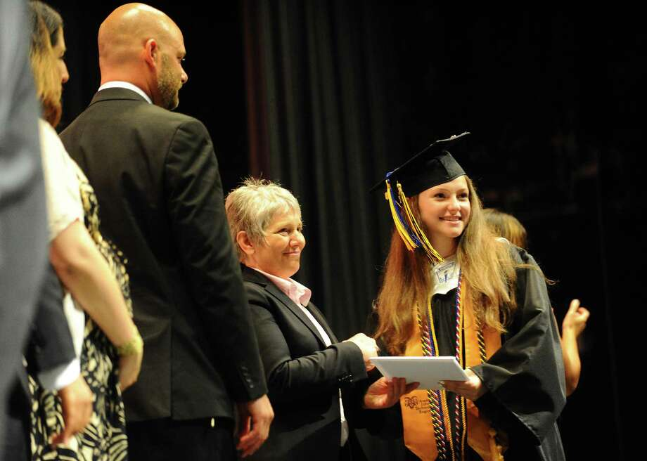 Gaby Baum, right, receives her diploma during the Academy of Information Technology and Engineering (AITE) graduation inside the Rippowam Middle School auditorium in Stamford, Conn. on Monday, June 19, 2017. Photo: Michael Cummo, Hearst Connecticut Media / Stamford Advocate