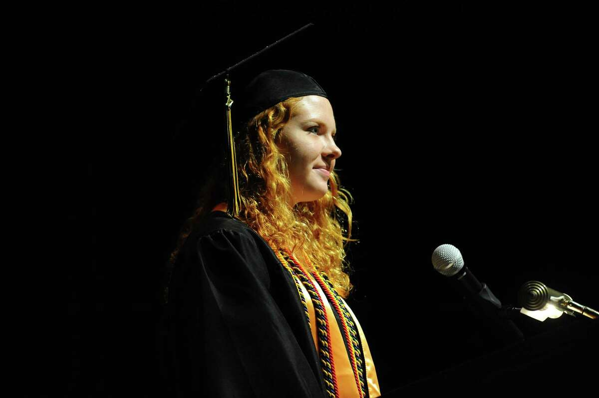 Academy of Information Technology and Engineering (AITE) class president Mollie Rutz stands at the podium before welcoming graduates and their families during the AITE graduation inside the Rippowam Middle School auditorium in Stamford, Conn. on Monday, June 19, 2017.