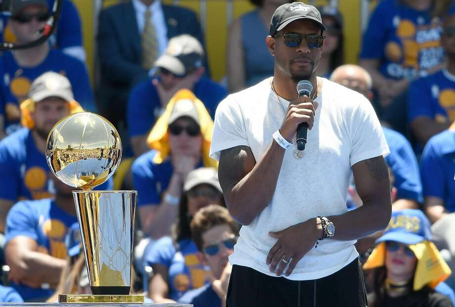 OAKLAND, CA - JUNE 15:  Andre Iguodala #9 of the Golden State Warriors talks to the fans while they celebrate the Warriors 2017 NBA Championship at The Henry J. Kaiser Convention Center during thier Victory Parade and Rally on June 15, 2017 in Oakland, California.  (Photo by Thearon W. Henderson/Getty Images) Photo: Thearon W. Henderson, Getty Images
