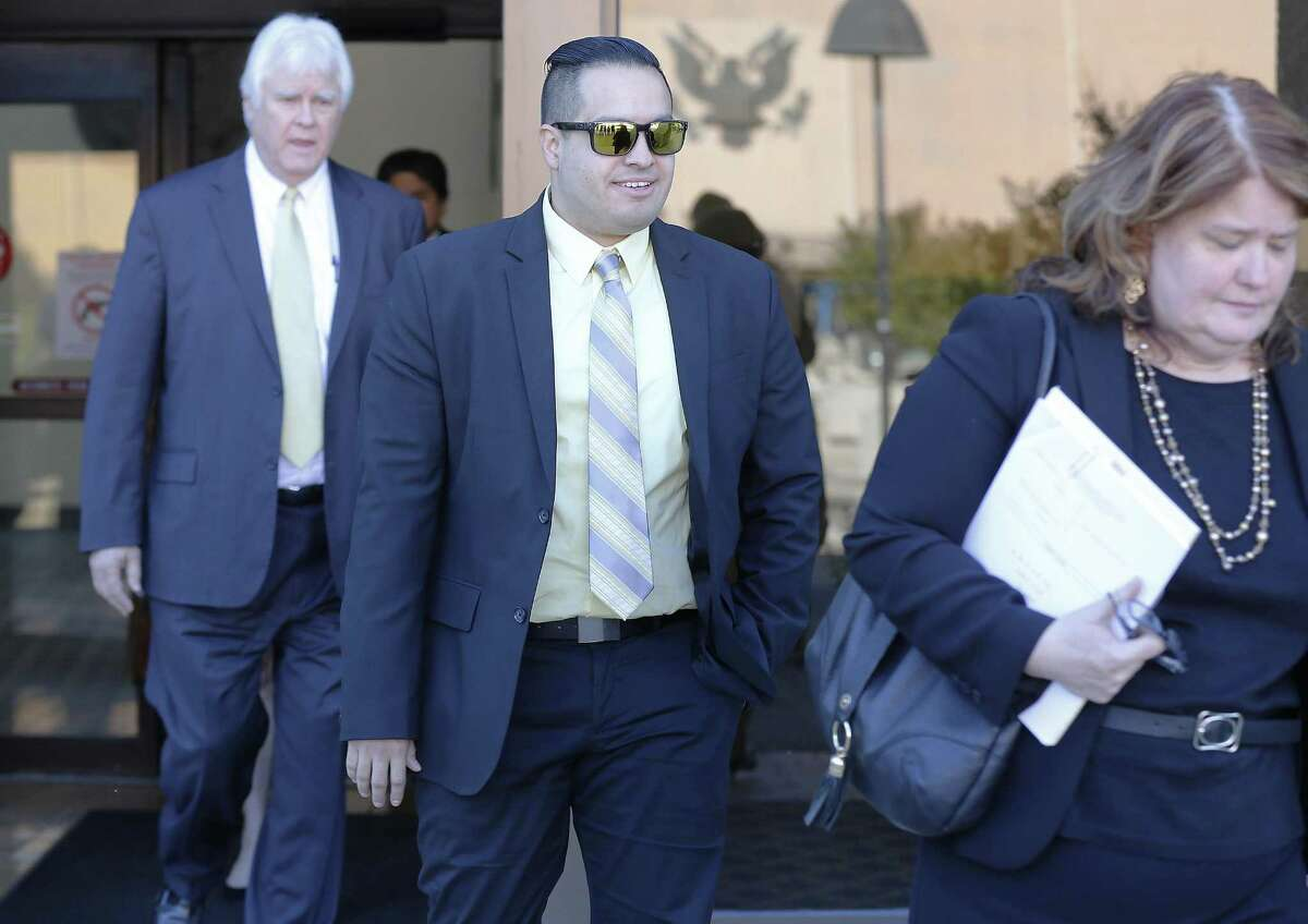 San Antonio Police Officer Robert Encina leaves the John Wood Federal Courthouse on April 6, 2017, after a federal jury found him not liable in the shooting death of Marquise Jones in 2014. Walking beside Encina is Debbie Klein, assistant city attorney.