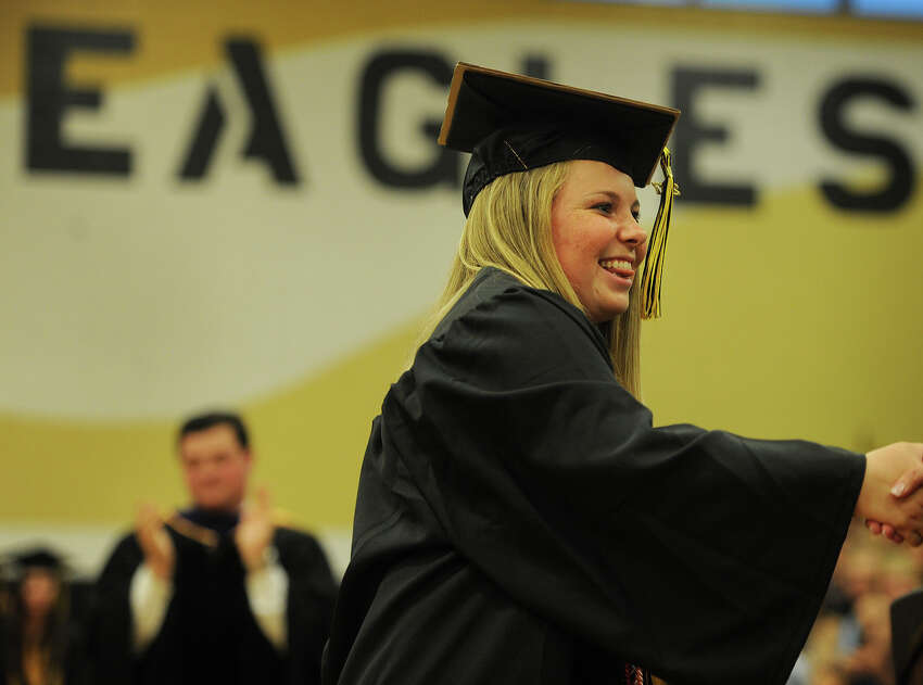 Salutatorian Emily Fox receives her diploma during the Trumbull High School Class of 2017 graduation in Trumbull, Conn. on Monday, June 19, 2017.