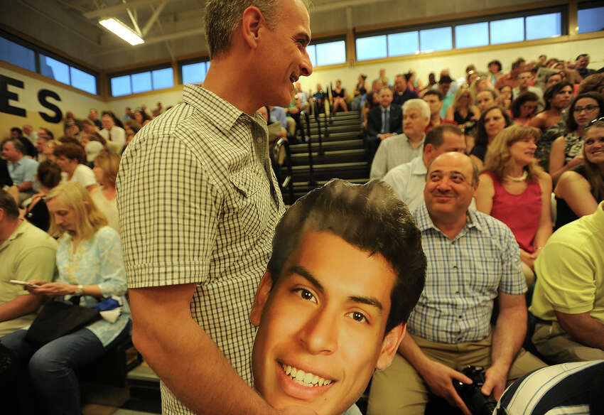 Chris Peterson brings a cutout of son and graduate Kyle Peterson to the Trumbull High School Class of 2017 graduation in Trumbull, Conn. on Monday, June 19, 2017.