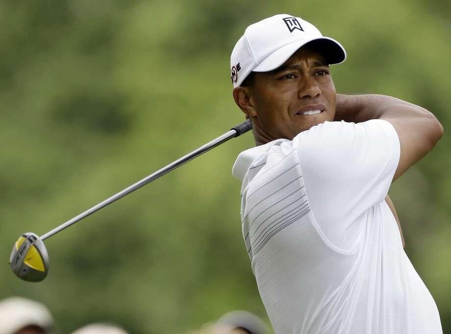 Tiger Woods watches his drive on the 11th hole during the first round of the Bridgestone Invitational golf tournament Thursday, Aug. 6, 2009, at Firestone Country Club in Akron, Ohio. (AP Photo/Mark Duncan) Photo: Mark Duncan, AP
