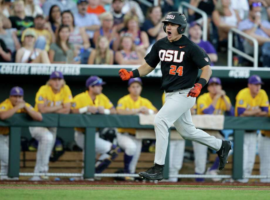 Oregon State's KJ Harrison is fired up rounding the bases after hitting a grand slam in the sixth. Photo: Nati Harnik, STF / Copyright 2017 The Associated Press. All rights reserved.