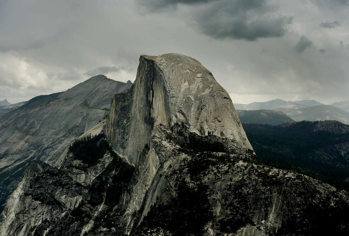 Vew of the Half Dome monolith from Glacier Point at the Yosemite National Park in California on June 4, 2015.