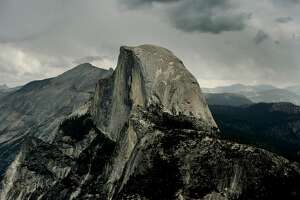 Vew of the Half Dome monolith from Glacier Point at the Yosemite National Park in California on June 4, 2015.  At first glance the spectacular beauty of the park with its soaring cliffs and picture-postcard valley floor remains unblemished, still enchanting the millions of tourists who flock the landmark every year. But on closer inspection, the drought's effects are clearly visible.                AFP PHOTO/MARK RALSTON        (Photo credit should read MARK RALSTON/AFP/Getty Images)