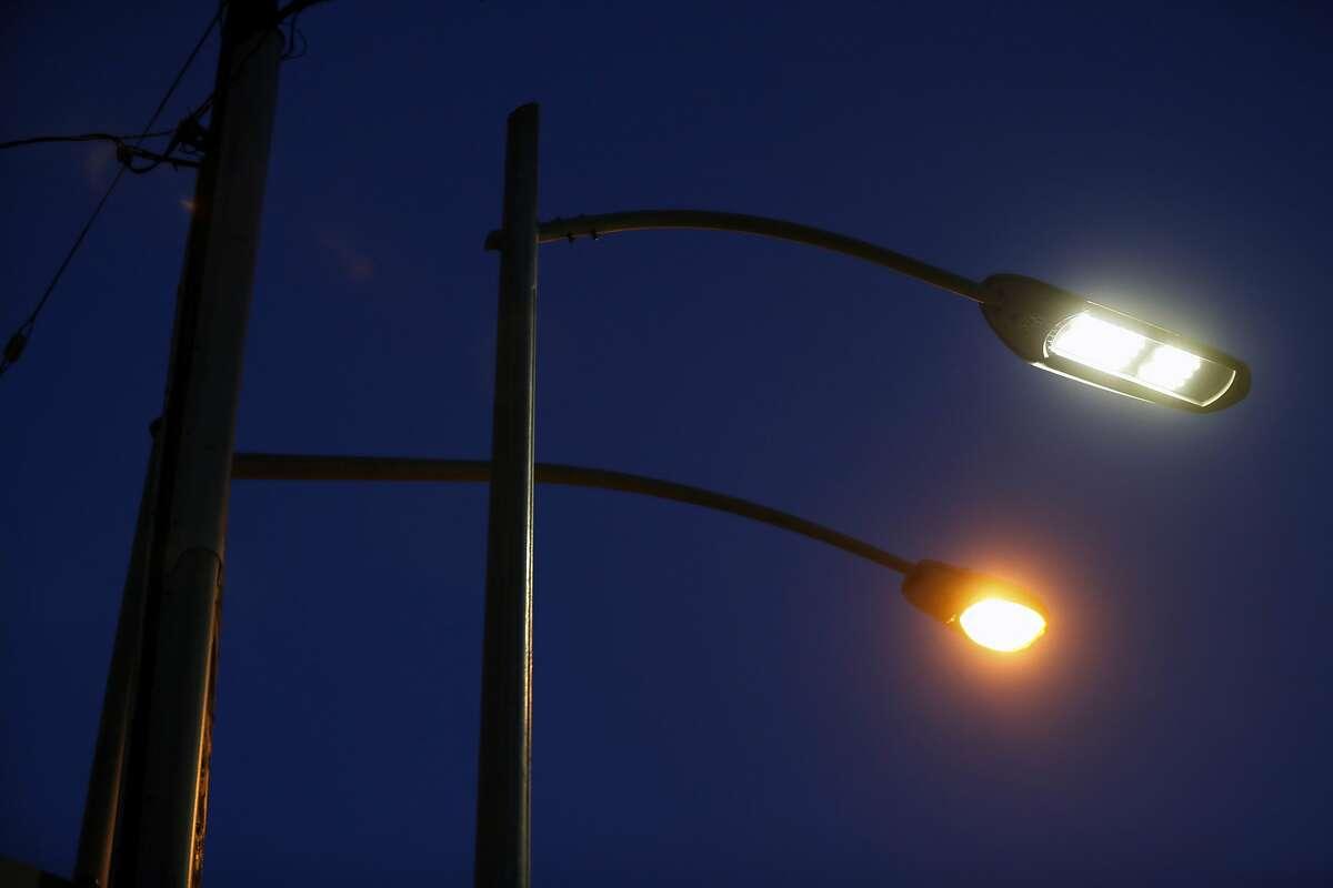 LED streetlight and an older sodium streetlight on Main Street in San Francisco, Calif., on Monday, June 19, 2017.
