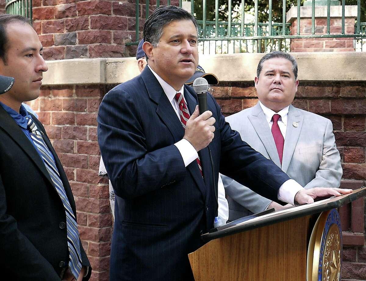 State Representative Richard Peña Paymond, at podium, speaks at a press conference, Monday, June 19, 2017, at Jarvis Plaza.
