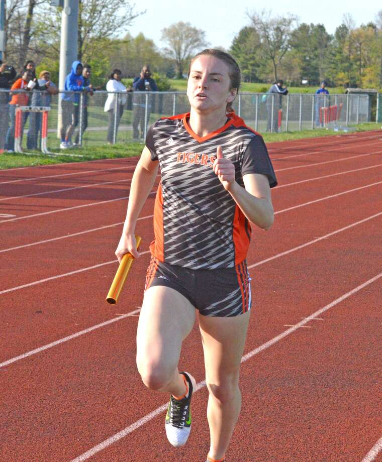Edwardsville's Lorie Cashdollar runs in the 3,200-meter during the Tiger Relays at EHS.