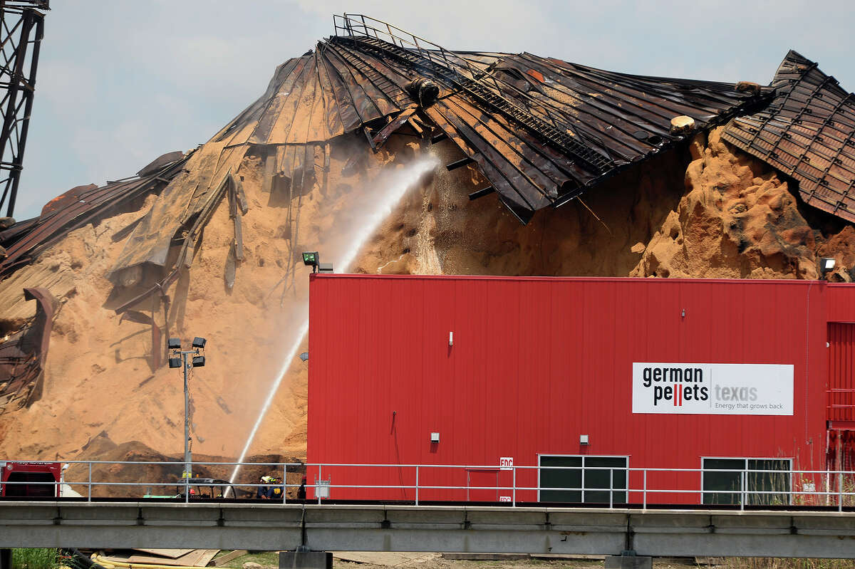 Water is sprayed on a pile of wood pellets that have been smoldering since February in Port Arthur on Monday. The silo collapsed two weeks ago, and now an increase in temperature has been noticed in an adjacent silo. Photo taken Monday 6/19/17 Ryan Pelham/The Enterprise