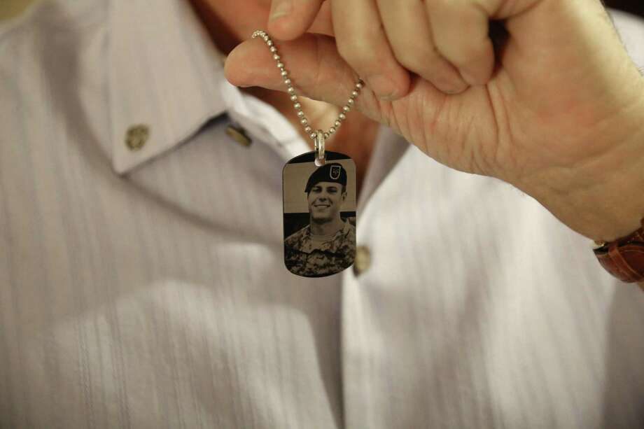 This June 17, 2017 photo shows a dog tag made in memorial of fallen U.S. Green Beret Kevin McEnroe worn by his father Brian in Amman, Jordan. Both Brian McEnroe and James Moriarty, fathers of two of the three American soldiers who were shot dead at a Jordanian military base, are attending the latest hearing in the trial here of the Jordanian serviceman accused of killing them. group. (AP Photo/Sam McNeil) Photo: Sam McNeil, STF / Associated Press / AP