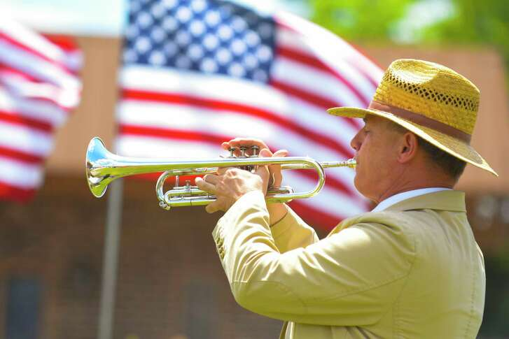 Tomball recently held a Flag Day event to recognize and honor the U.S. Flag. Bugler Randy Richter play taps and other patriotic songs.
