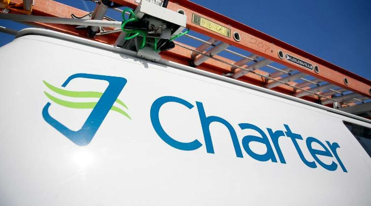 Charter Communications says that Verizon and other utilities is slowing down the expansion of its broadband Internet network in upstate.