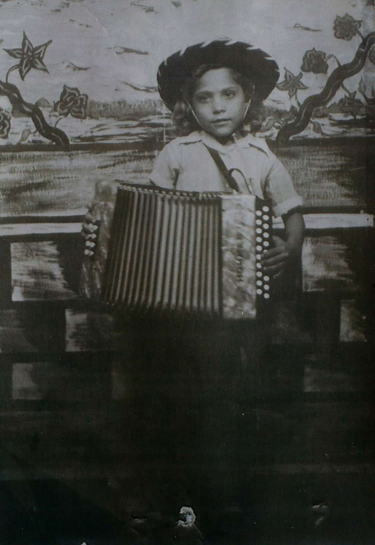 Eva Ybarra has been playing the accordion since the age of 4. Ybarra believes she is 5 or 6 in this photograph.