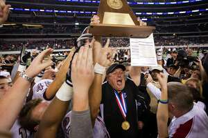 Pearland head coach Tony Heath hoists the championship trophy the Oilers defeated the Euless Trinity Trojans for the state title of the Class 5A, Division 1 state championship game at Cowboys  Stadium on Saturday, Dec. 18, 2010, in Arlington.  Pearland won the game 28-24.  ( Smiley N. Pool / Houston Chronicle )