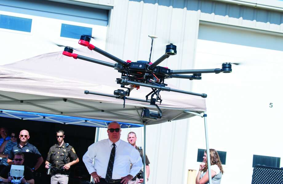 Madison County Sheriff John Lakin, center, watches during Tuesay morning's drone demonstration in at the sheriff's office in downtown Edwardsville. Photo: Zach Foote
