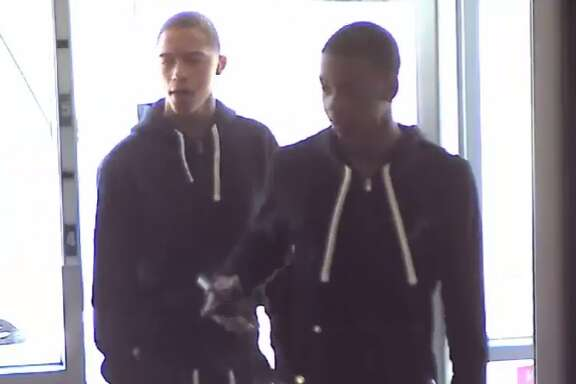 Houston police are searching for two suspects who were caught on video robbing a T-Mobile store in the Champions area on Wednesday, April 5 at about 3:50 p.m.