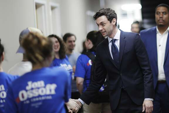 Democratic candidate for 6th congressional district Jon Ossoff, right, greets supporters as he leaves a campaign office in Marietta, Ga., Tuesday, June 20, 2017. The most expensive House race in U.S. history heads to voters Tuesday in suburban Atlanta. Either Republican Karen Handel will claim a seat that's been in her party's hands since 1979 or Ossoff will manage an upset that will rattle Washington ahead of the 2018 midterm elections. (AP Photo/David Goldman)