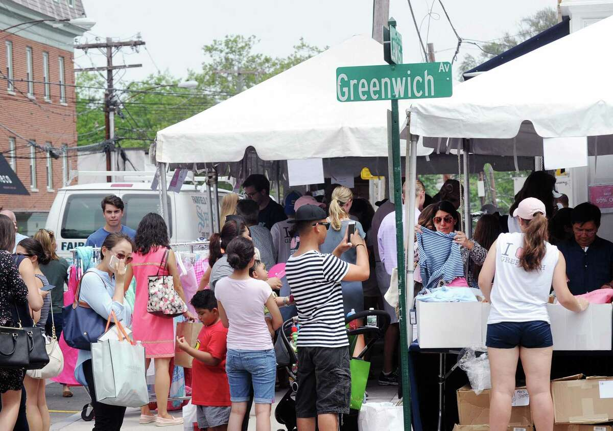 The annual Sidewalk Sales organized by the Greenwich Chamber of Commerce on Greenwich Avenue.