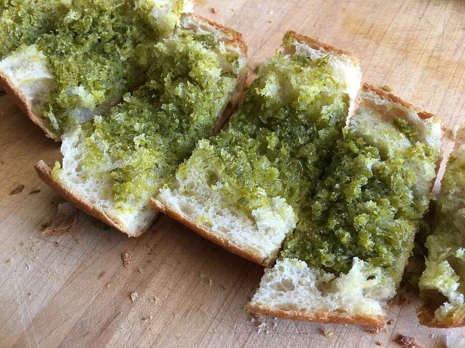 Garlic scapes put a savory twist on garlic bread. Photo: Sarah Fritsche